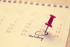 Calendar and marked the date on Holiday vintage tone Stock Photo