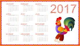 Calendar 2017 med den felika ungtuppen på vit - kinesiskt symbol av det nya året Arkivfoto
