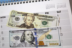 Calendar and money background Stock Photo