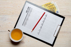 Calendar with money on wooden desk Royalty Free Stock Photography