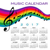 A 2017 calendar with a musical score. And a rainbow Stock Photos