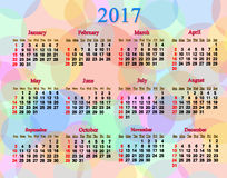 Calendar for neat 2017 year with multicolored rings and circles. Calendar for next 2017 year on the multicolored rings and circles Stock Photos