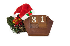 Calendar with New Year Date, Santa hat, decorations on white. Stock Photos