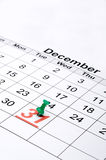 A calendar with New Year's day marked with a g. Vertical image of a calendar with New Year's day marked with a green tack Stock Photo