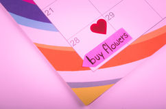 Calendar with a note to buy flowers Stock Photography