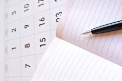 Calendar, notebook blank page and black pen Royalty Free Stock Image