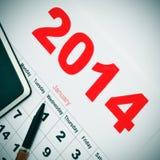 2014 calendar and notebook. Closeup of a desk with a notebook and a 2014 calendar Stock Photo