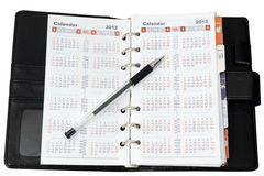 Calendar in notebook with pen Stock Photo