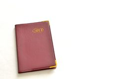 2014 calendar and notebook. On white background Stock Photos