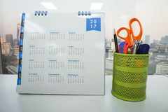 2017 calendar on office table with stationary in box Stock Image
