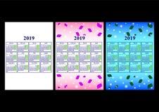 Calendar 2019 på en härlig bakgrund av sidor och färgrika cirklar Arkivbilder
