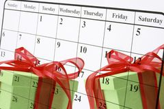 Calendar Page and Gift Boxes. Composite of Calendar Page and Gift Boxes royalty free stock photo