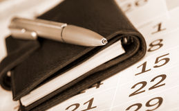 Calendar page, pen and pocket planner royalty free stock image