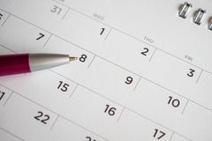 Calendar page with pen point at 8th date. Close up royalty free stock photography