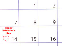 Calendar page with a red hand written heart highlight royalty free stock photo