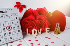 Calendar page with a red hand written heart highlight on February 14 of Saint Valentines day stock photo