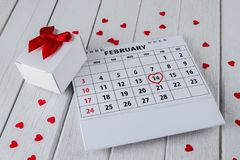 Calendar page with a red hand written heart highlight on February 14 of Saint Valentines day stock photography