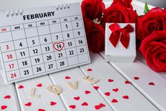 Calendar page with a red hand written heart highlight on February 14 of Saint Valentines day. Calendar page with red hand written heart highlight on February 14 stock photography