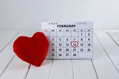 Calendar page with a red hand written heart highlight on February 14 of Saint Valentines day stock image
