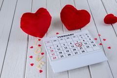 Calendar page with a red hand written heart highlight on February 14 of Saint Valentines day stock photos