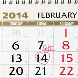 Calendar page with red heart on February 14 2014. Royalty Free Stock Image