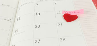 Calendar page with red heart on 14 February - Valentine day Stock Image