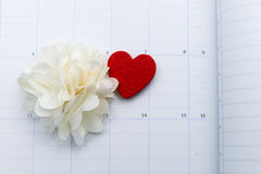 Calendar page with red heart and flower note on valentine day Royalty Free Stock Image