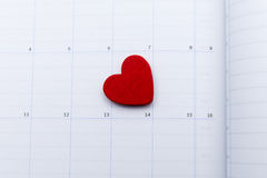 Calendar page with red heart note on valentine day Royalty Free Stock Image