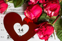 Calendar page with the red hearts and bouquet of red roses on Valentines day. Calendar page with the red hearts and bouquet of red roses on February 14 of Saint Royalty Free Stock Photography