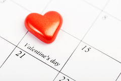 Calendar page with the red hearts on February 14 Royalty Free Stock Photo