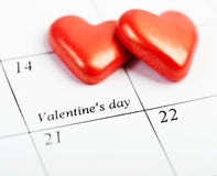 Calendar page with the red hearts on February 14 Royalty Free Stock Images