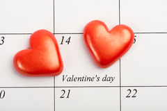 Calendar page with the red hearts on February 14 Royalty Free Stock Image