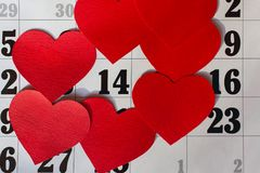 Calendar page with the red hearts on February 14 of Saint Valentines day.  vector illustration