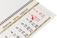Calendar page with red thumbtack on February 14 2014. stock photo