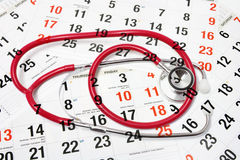 Calendar Pages and Stethoscope Royalty Free Stock Images