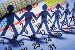 Calendar and Paper Cutout Dolls Stock Photography