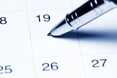 Calendar with pen Stock Images