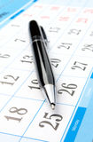 Calendar and a pen Stock Images