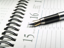 Calendar and pen close-up royalty free stock image