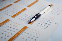 Calendar and pen close-up Stock Photography