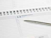 Calendar and pen. friday 13 royalty free stock photography