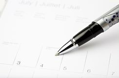 Calendar pen july 4. Close up of calendar and pen july 4 Royalty Free Stock Photo