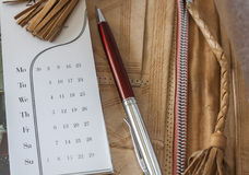 Calendar And Pen On Leather Folder. Pen And Calendar On Leather Folder Close Up Royalty Free Stock Images