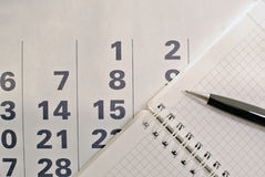 Calendar, pen and notebook with blank pages Stock Images