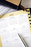 Calendar. Pen point to calendar put beside books Royalty Free Stock Images