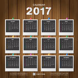2017 Calendar. Photo frame with pin on wooden wall background, R. Etro design template. Week starts Sunday. Vector illustration Stock Images