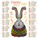 Calendar for 2017 with a picture of Christmas rabbit in bright colorful costumes. The annual calendar. Christmas rabbit in bright colorful costumes Royalty Free Stock Images
