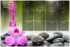 Calendar 2016. 2016 calendar Pink orchid and spa stone background Royalty Free Stock Photography