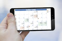 Calendar planner cell phone Stock Images