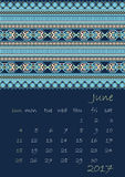 2017 Calendar planner with ethnic cross-stitch ornament on dark blue background Week starts on Sunday. Vector illustration. From collection of Balto-Slavic Stock Illustration